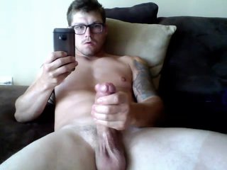 Hot Hung Tattooed Guy With Glasses Wanks On Cam